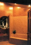1980 Excelsior - tiled bathroom with round window - custom home by Rick Bernard Custom Homes.