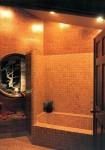 1980 Excelsior - tiled bathroom with round window - custom home by Rick Bernard Custom Homes.