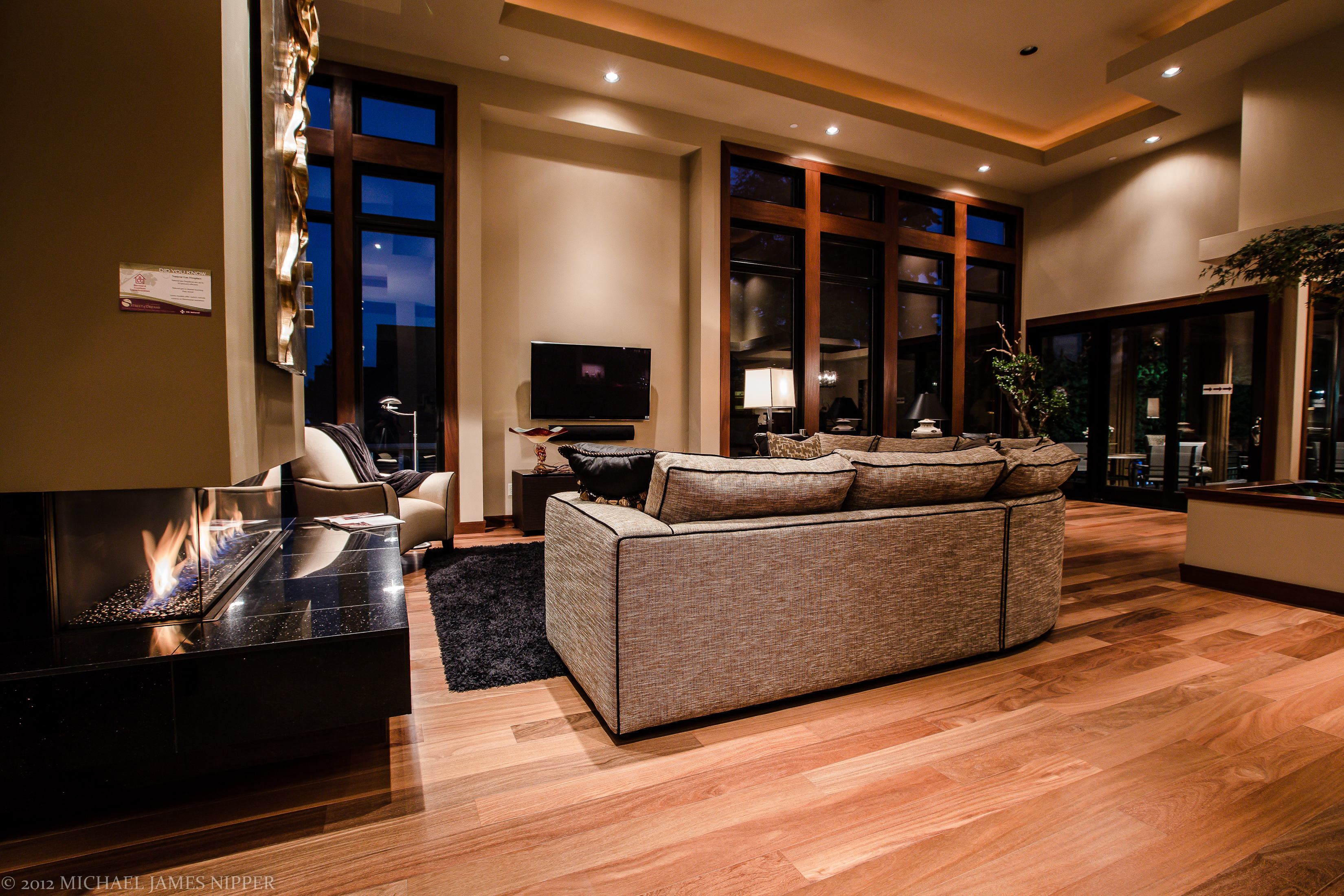 Living room with televisioin of 2013 Street of Dreams Custom Home 20-20 by Rick Bernard of Bernard Custom Homes.