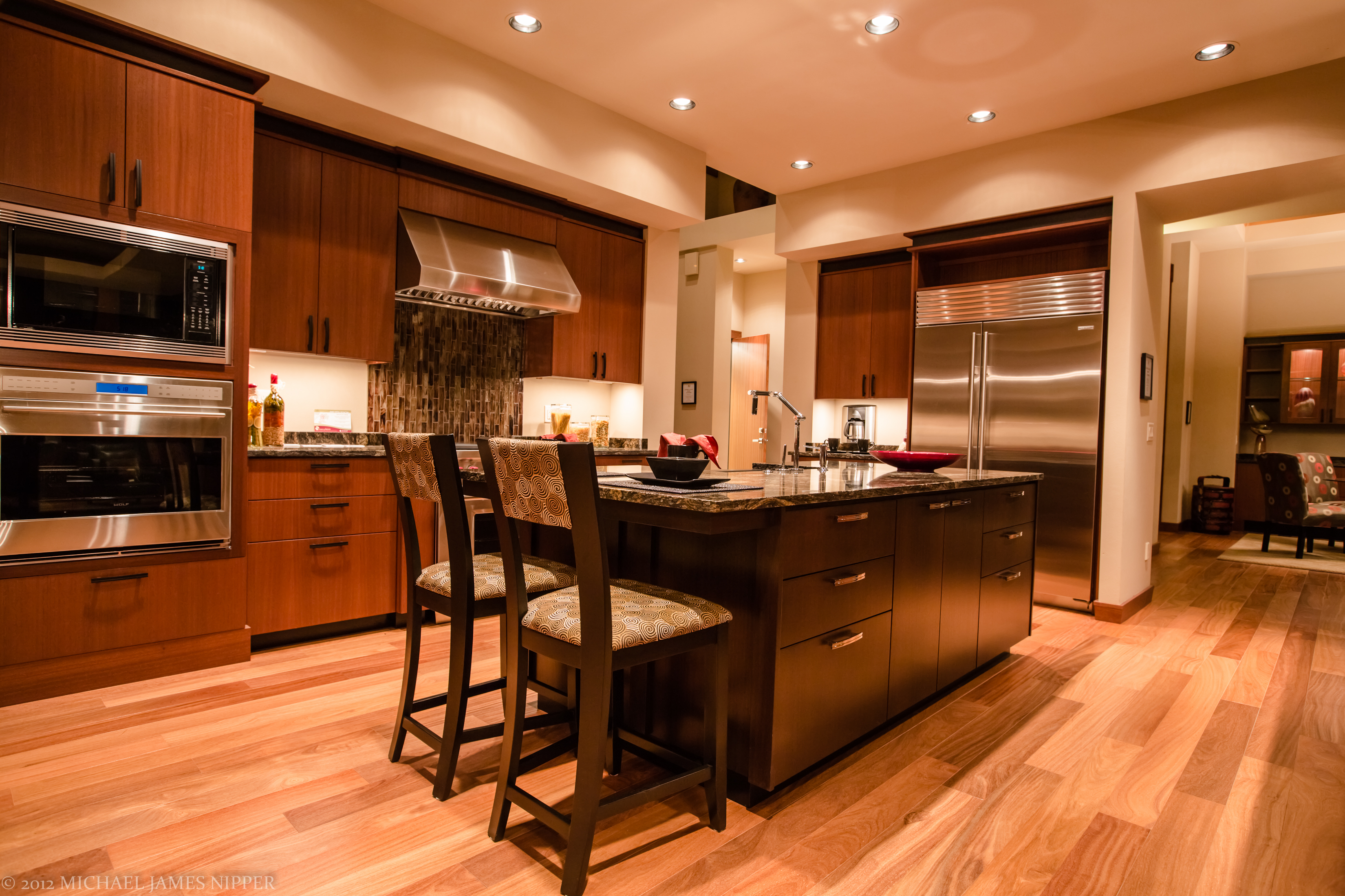 Kitchen island of 2013 Street of Dreams Custom Home 20-20 by Rick Bernard of Bernard Custom Homes.