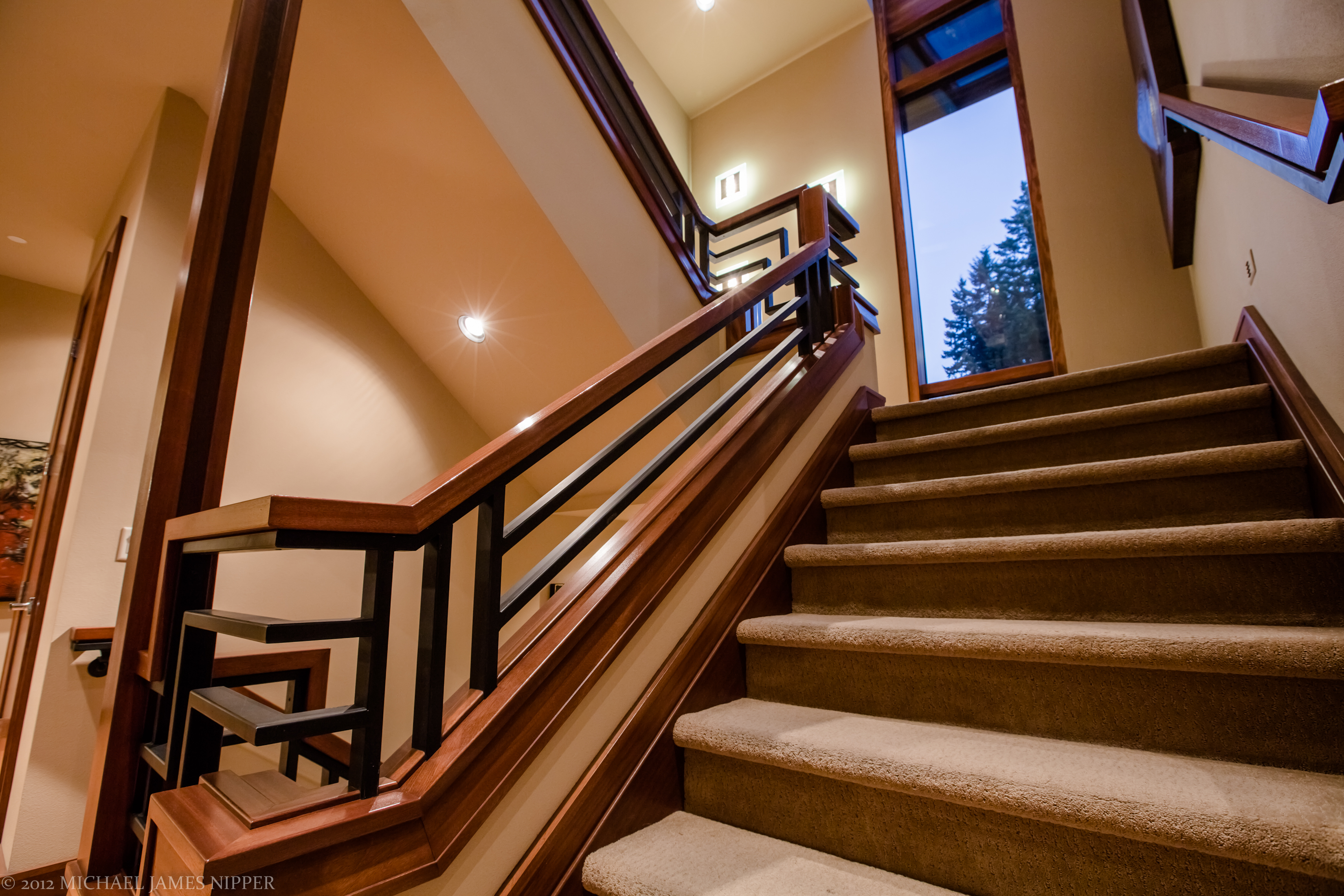 Looking up the stairwell from first to second floor of 2013 Street of Dreams Custom Home 20-20 by Rick Bernard of Bernard Custom Homes.