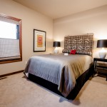 Bedroom with bed of 2013 Street of Dreams Custom Home 20-20 by Rick Bernard of Bernard Custom Homes.