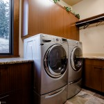 Laundry room with washer and dryer of 2013 Street of Dreams Custom Home 20-20 by Rick Bernard of Bernard Custom Homes.