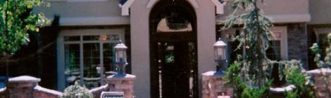 Oregon Fir 2001 front entrance landscape - Street of Dreams custom home by Rick Bernard Custom Homes.