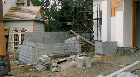 Cconstruction phase - concrete block construction awaiting veneer of stone or brick in a custom home built by Rick Bernard.