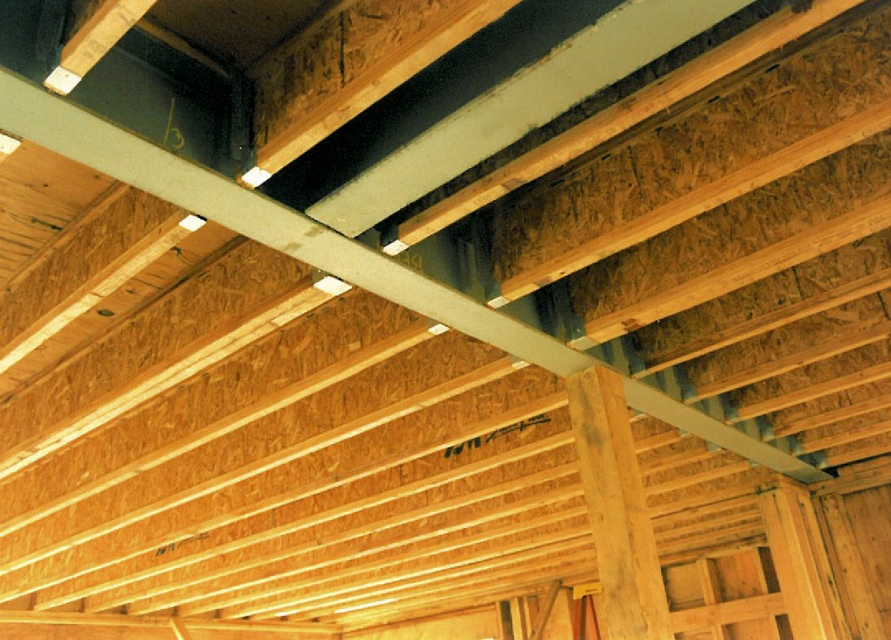 Construction Phase Steel I Beams Recessed In Ceiling To Pick Up Point Loads From