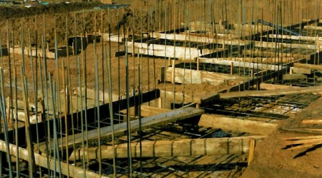 Forest of rebar and concret foundation forms - custom homes by Rick Bernard.